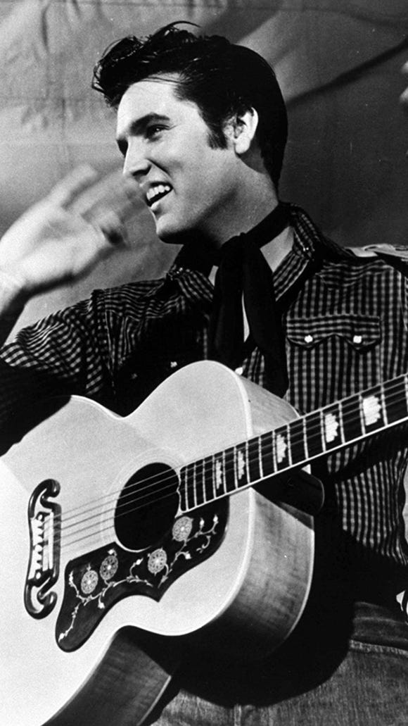 Elvis Presley is shown in 1957
