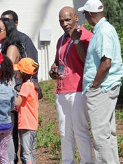 Boxing legend Mike Tyson takes in some tennis early Saturday at the BNP Paribas Open at the Indian Wells Tennis Garden.