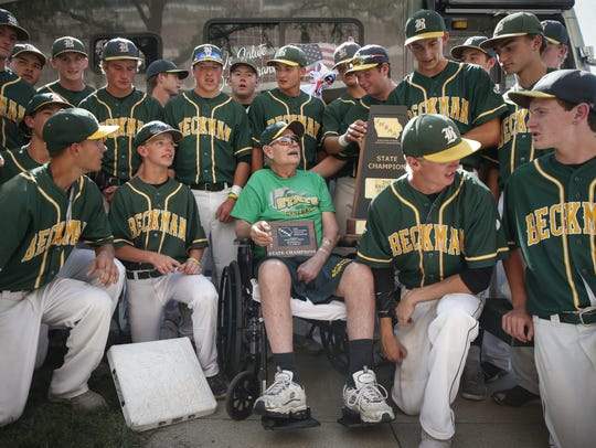 Members of the Beckman Catholic baseball team celebrate