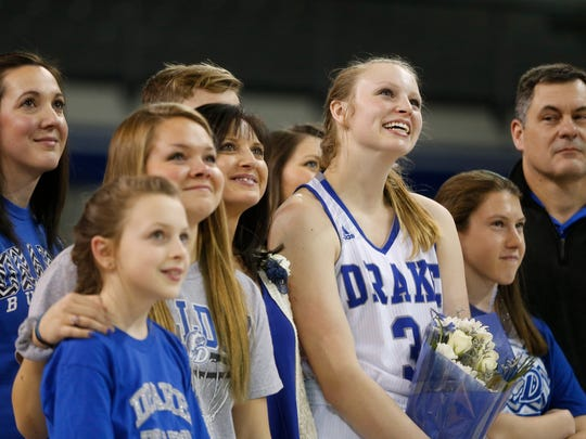 Drake forward Lizzy Wendell (3) looks at video messages from her teammates Saturday, March 4, 2017 as she is recognized during a senior night ceremony following their win against Wichita State at the Knapp Center in Des Moines.