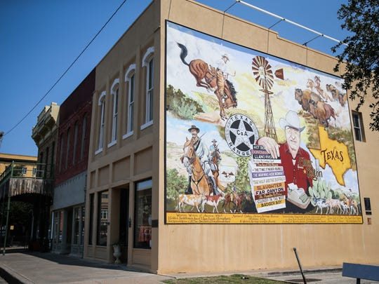 A mural commemorating the work of Elmar Kelton, known for his Western novels, in downtown San Angelo.