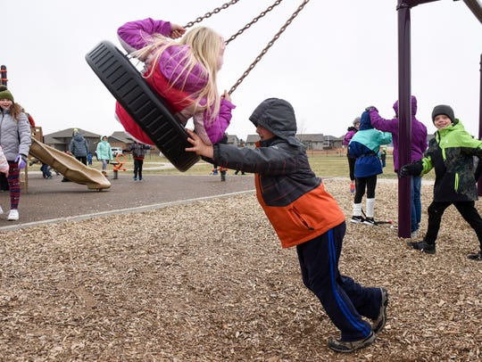 Students at R.F. Pettigrew Elementary School play on