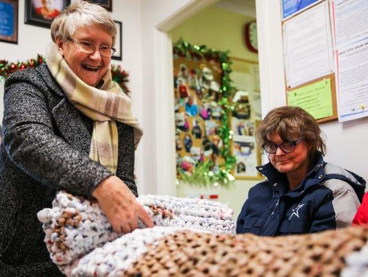 Mosaic grocery-bag mats for homeless