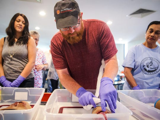 Participants learn to pack a wound during a civilian response to active shooter training Saturday, June 2, 2018, at St. Paul Presbyterian Church.