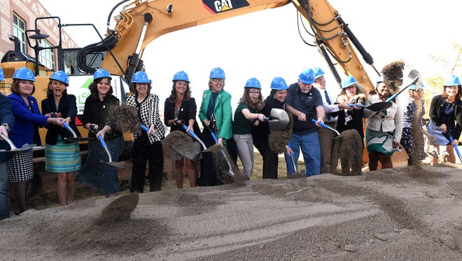 Local dignitaries, students, and WCSD employees shovel dirt during the groundbreaking ceremony for the new expansion at Damonte Ranch High School in Reno on March 16, 2017.