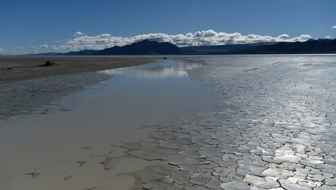 Water is seen covering the Black Rock Desert playa north of Gerlach, Nevada on March 25, 2017.