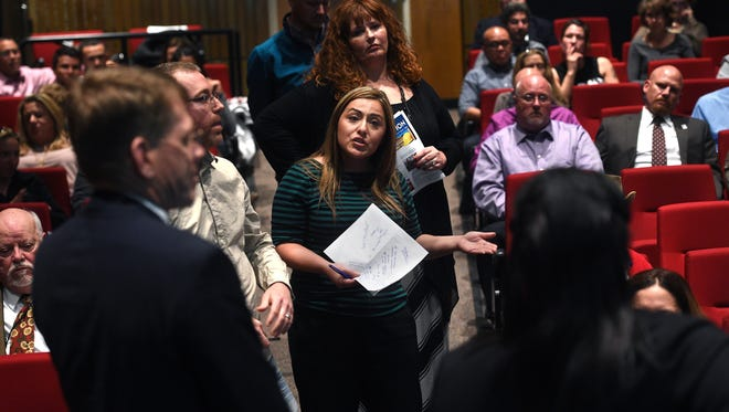 Aurora Delao, middle, a fourth grade teacher, asks a question to Superintendent Traci Davis and CFO Tom Ciesynski during a town hall meeting at Wooster High School in Reno with regards to the Washoe County School District budget on April 6, 2017.
