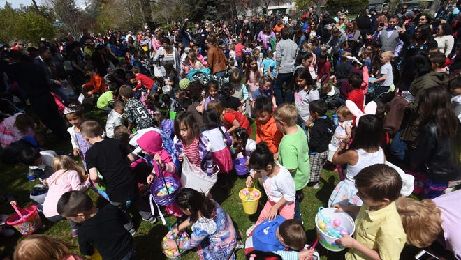 Hundreds of families take part in the Community Easter Egg Dash at Idlewild Park in Reno on April 15, 2017.