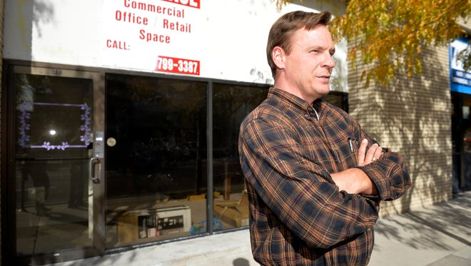 """Bob Wigdorski, executive director of Gateway Community Services, stands outside of the new Gateway addiction drop-in center, which used to be a bridal shop on 1st Avenue North. """"It's just a safe, sober place for people to spend their day in a good atmosphere,"""" he said."""
