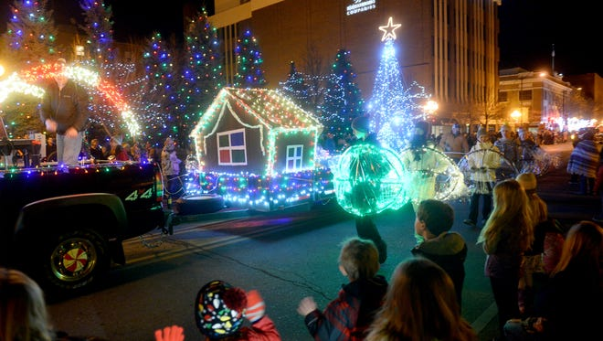 The crowd cheers as lighted floats make their way down Central Avenue at last year's Parade of Lights.