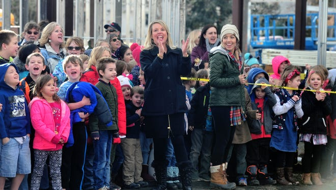 """Tammy Lacey, superintendent of Great Falls Public Schools, leads the students of Roosevelt Elementary School in a """"thank you"""" cheer to the construction workers building Giant Springs Elementary School, Thursday, during a """"topping out"""" ceremony celebrating the final steel beam being fitted to the new building."""