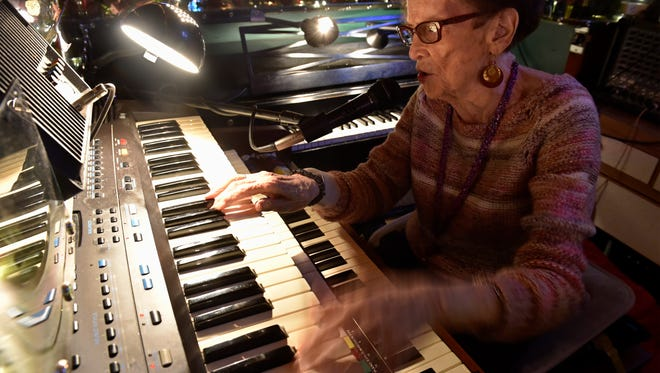 Pat Spoonheim, better known as Piano Pat, plays on a recent Wednesday night at the Sip 'n' Dip. She has played piano at the bar since 1963.