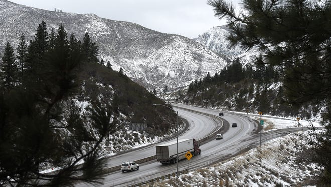 Traffic makes its way west on Interstate 80 near Floriston on a snowy Thursday morning, Feb. 22, 2018.