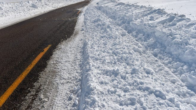 Snow drifts over a roadway north of Cut Bank. Northcentral Montana is expected to receive 4-6 inches of snow Thursday with the possibility of more over the weekend.