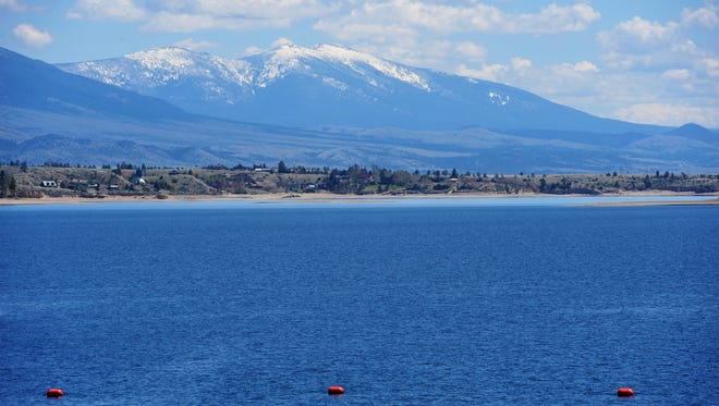 Snow from the Little Belt Mountains helps fill Canyon Ferry Lake.