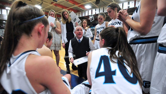 Great Falls High coach Jerry Schmitz huddles with his team during the second girls' crosstown basketball game in the Swarthout Fieldhouse. The Bison girls will be the No. 4 team from the Eastern AA at next week's state tournament in Butte.