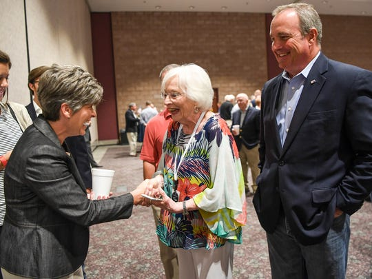 U.S. Sen. Joni Ernst, left, of Iowa shakes hands with Diane Duncan, middle, near her son U.S. Rep. Jeff Duncan, right, during the Faith & Freedom barbecue at the Civic Center of Anderson on Monday.