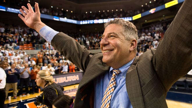 Auburn head coach Bruce Pearl celebrates after the NCAA basketball game on Wednesday, Feb. 14, 2018, in Auburn, Ala. The No. 11-ranked Tigers defeated Kentucky, 76-66, at Auburn Arena