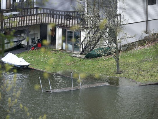 Rising water levels in the Irondequoit Bay area as