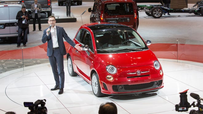 Matt McAlear, Fiat Chrysler's senior manager of product development for passenger car brands, introduces the 2018 Fiat 500 at the Chicago Auto Show on Thursday.