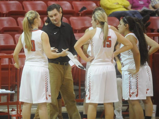 Flippin head coach Jason Hughes instructs players during a timeout against Jasper on Thursday night.