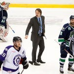 Florida Everblades coach Greg Poss, center, argues with officials after the first period of Wednesday's game against Reading at Germain Arena.