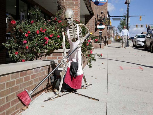 A skeleton appears to sweep on Center Street during