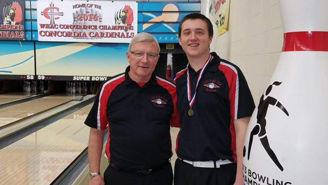 Coldwater junior Alec Keplinger (right) and head coach Frank DeMond stand at Super Bowl in Canton after Keplinger won the MHSAA Division 2 Individual State Championship on March 3, 2018.