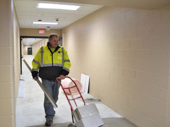Tim Harmann of Samuels Group, who has served as construction supervisor of the Oconto County Law Enforcement Center project, walks out of the new section of the secure corridor from the jail toward the courthouse in late January. Inmates will be escorted through the corridor for court appearances.
