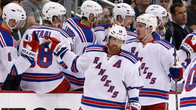 New York Rangers' Brad Richards (19) celebrates with teammates after his goal in the second period of game 7 of a second-round NHL playoff hockey series against the Pittsburgh Penguins in Pittsburgh Tuesday, May 13, 2014.