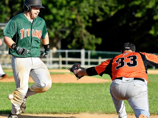 Stoverstown's J.W. Besore, right, looks for the ball as Jefferson's Jordan Witmer reaches safely at first on Thursday.