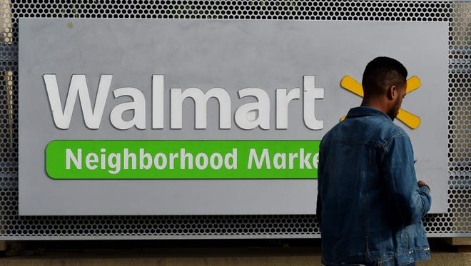 A manwalking past a Walmart store in Chinatown, Los Angeles. US retail behemoth Walmart is in preliminary talks to acquire health insurer Humana, the Wall Street Journal reported late on March 29, 2018.