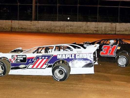 Gary Stuhler (No. 1) speeds past Barry Miller at the drop of the green and went on to dominate the Late Model feature at Hagerstown Speedway on Saturday night.