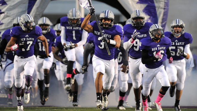The Ben Davis High School football team takes the field for the start of the game against Carmel held at Ben Davis High School, Oct. 18, 2013.