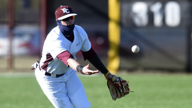 Earlham College's Brennan Laird tosses the ball to second to start a double play against Wittenberg University Wednesday, March 22, 2017 during a baseball game at Sadler Stadium in Richmond.