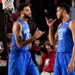 Mar 3, 2015; Athens, GA, USA; Kentucky Wildcats forward Karl-Anthony Towns (12) reacts with forward Willie Cauley-Stein (15) against the Georgia Bulldogs  at Stegeman Coliseum. Kentucky defeated Georgia 72-64. Mandatory Credit: Dale Zanine-USA TODAY Sports
