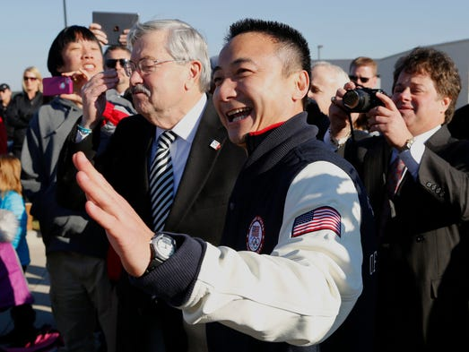 Gymnastics coach Liang Chow and Gov. Terry Branstad attend an unveiling ceremony for an Olympic sculpture outside of Chow's Gymnastic & Dance Institute Wednesday in West Des Moines.