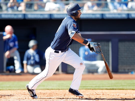 San Diego Padres' Eric Hosmer grounds into a double play during the third inning of a spring training baseball game against the Kansas City Royals, Friday, March 2, 2018, in Peoria, Ariz. (AP Photo/Charlie Neibergall)