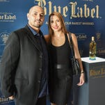 E.J. Calvo stands with his wife, Jackie Calvo, and his latest project, the Limited Edition Guam Johnnie Walker Blue bottle unveiling at the Dusit Thani Guam Resort on July 30.