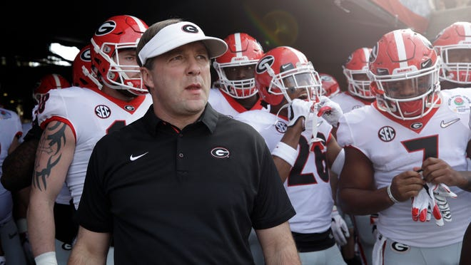 FILE - In this Monday, Jan. 1, 2018, file photo, Georgia head coach Kirby Smart waits with his team to run onto the field before the Rose Bowl NCAA college football game against Oklahoma in Pasadena, Calif. Smart is concerned the emotional drain from the Rose Bowl playoff semifinal win over Oklahoma could affect his team's ability to regroup for the national championship game against Alabama. (AP Photo/Jae C. Hong, Filee)