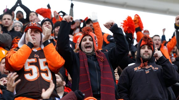 Bengals fans cheer as the Bengals face the Chargers at Paul Brown Stadium for a playoff game.