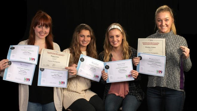 Richmond High School Pierian yearbook students Megan Crass, Hannah Crail, Katelyn Vierk  and Brooklyn Vickers pose with their certificates.