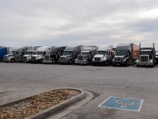 Tractor-trailer trucks are lined at the Pilot Travel