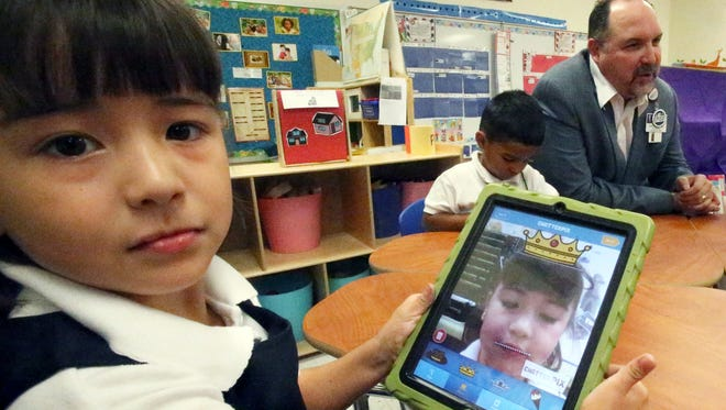 Melanie Martinez, 4, takes a self-portrait while working on an iPad in her prekindergarten dual-language class at Hart Elementary School earlier in the school year.