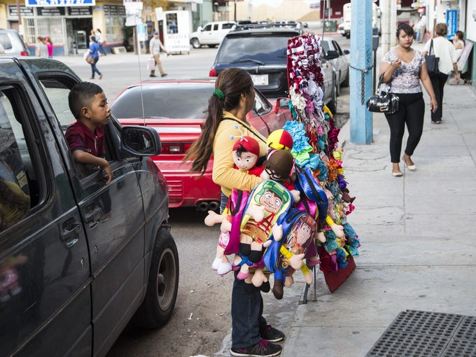 A typical scene in Nogales, Mexico: A child  sitting