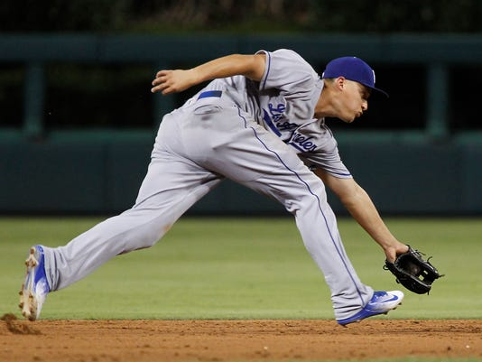 Los Angeles Dodgers shortstop Corey Seagar fields a single by Philadelphia Phillies' Peter Bourjos during the fifth inning of a baseball game against the Wednesday, Aug. 17, 2016, in Philadelphia. The Dodgers won 7-2. (AP Photo/Tom Mihalek)