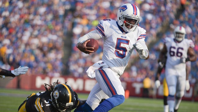 Buffalo Bills quarterback Tyrod Taylor (5) gets past Pittsburgh Steelers inside linebacker Sean Spence (51) on a touchdown run during the second half of a preseason NFL football game on Saturday, Aug. 29, 2015, in Orchard Park, N.Y.
