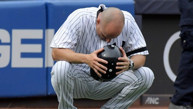 New York Yankees third base coach Joe Espada reacts after a young girl was hit by a line drive during the fifth inning Thursday.