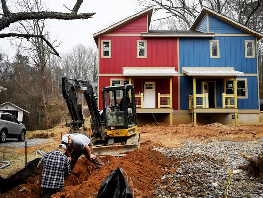 Ground Floor Properties NC has a nearly finished duplex building on State Street. Each 1,100-square-foot unit is selling for $279,000.