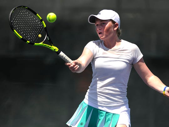 Katherine Petty returns a ball during her match with